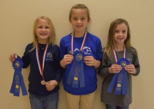 three girls holding their blue ribbons