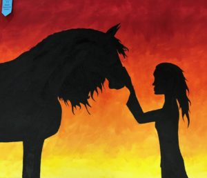 silhouette of girl and horse with sunset in background