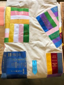quilt designed with award ribbons