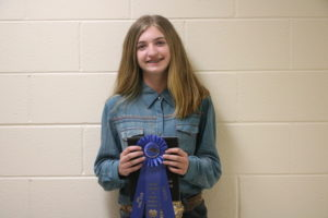 Abby Ragan holding the winning ribbon