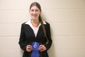 Cassandra Sigmon holding the winning ribbon