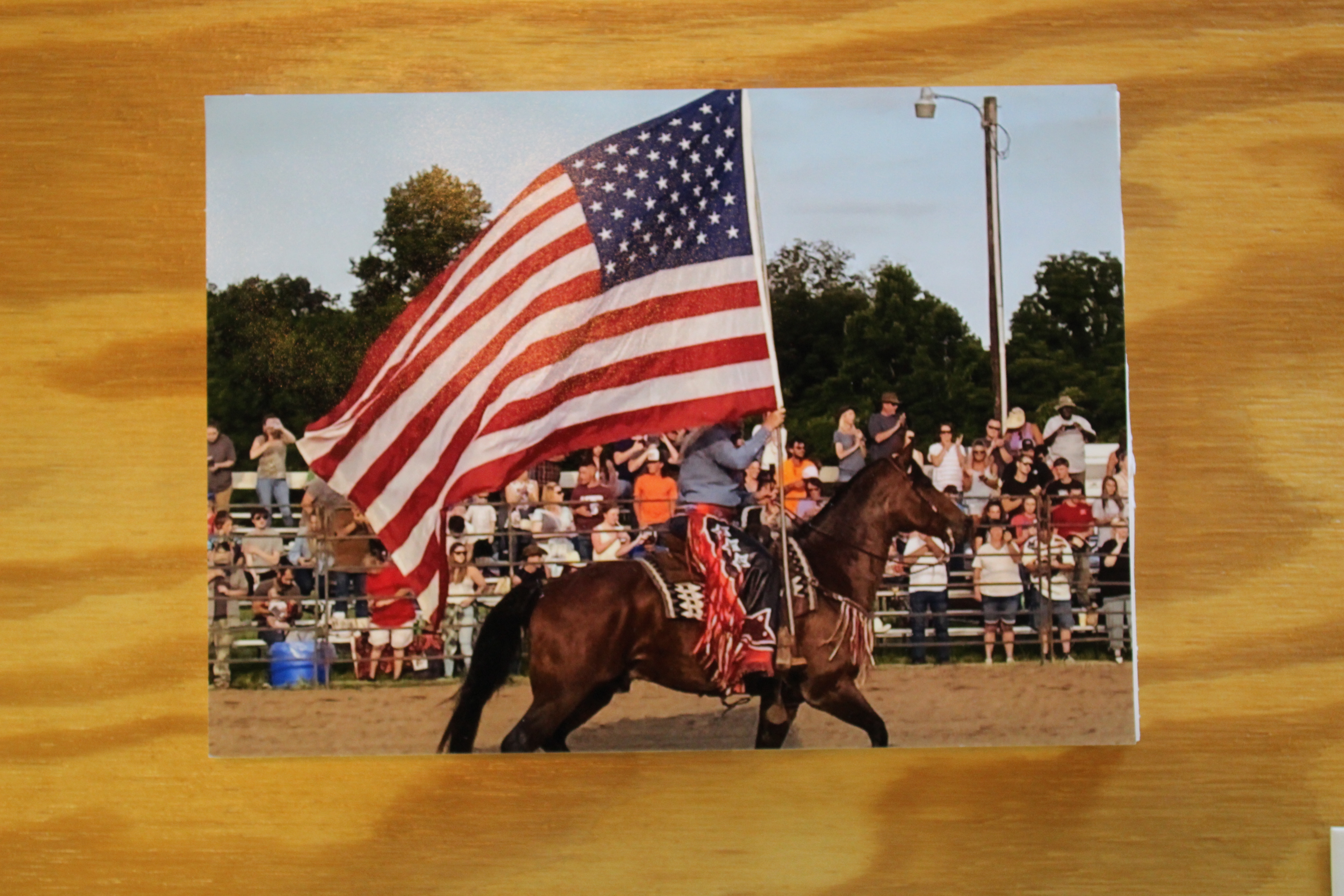 Photo of a man on horse carrying a flag