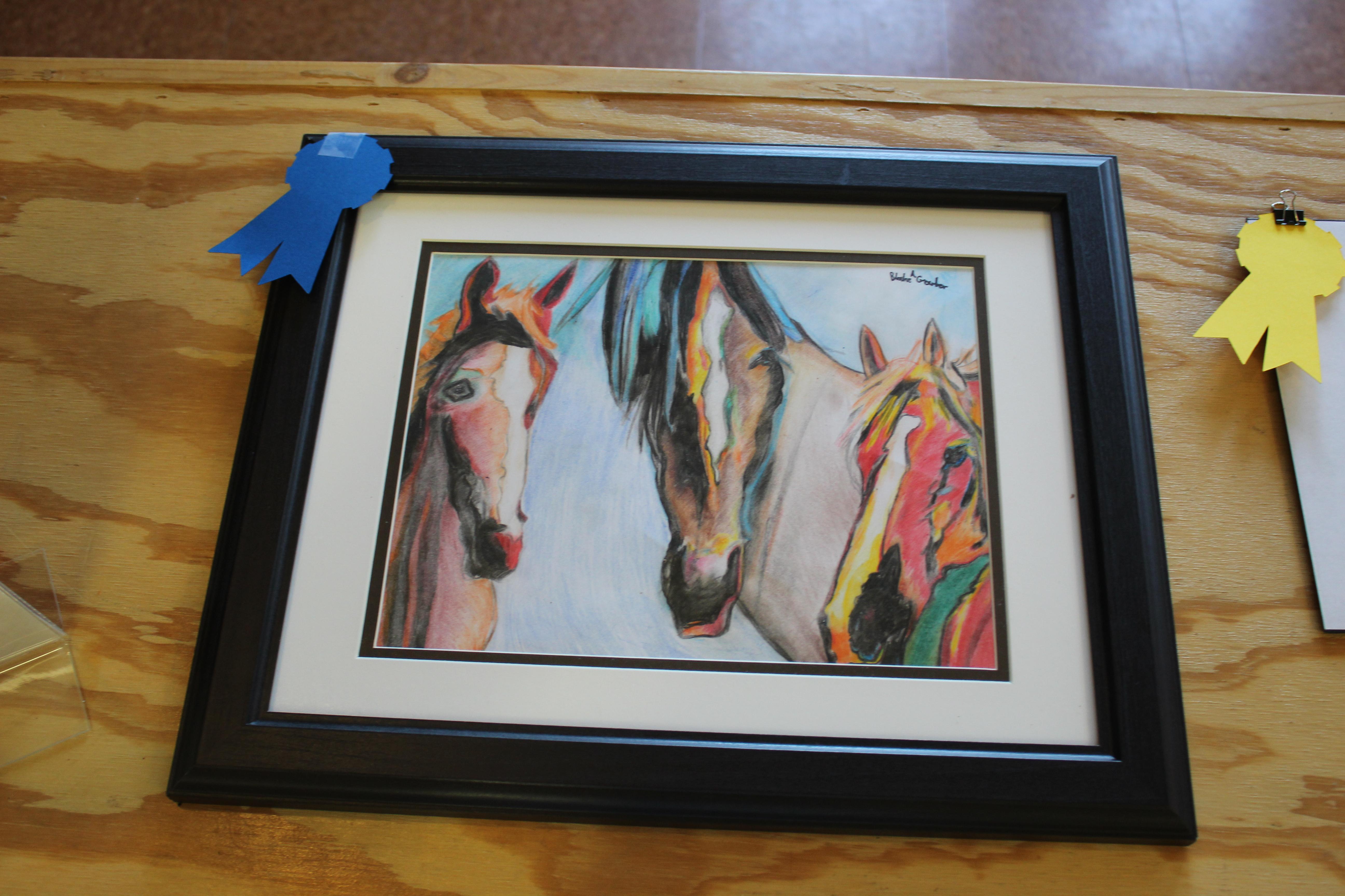 Drawing of three horses